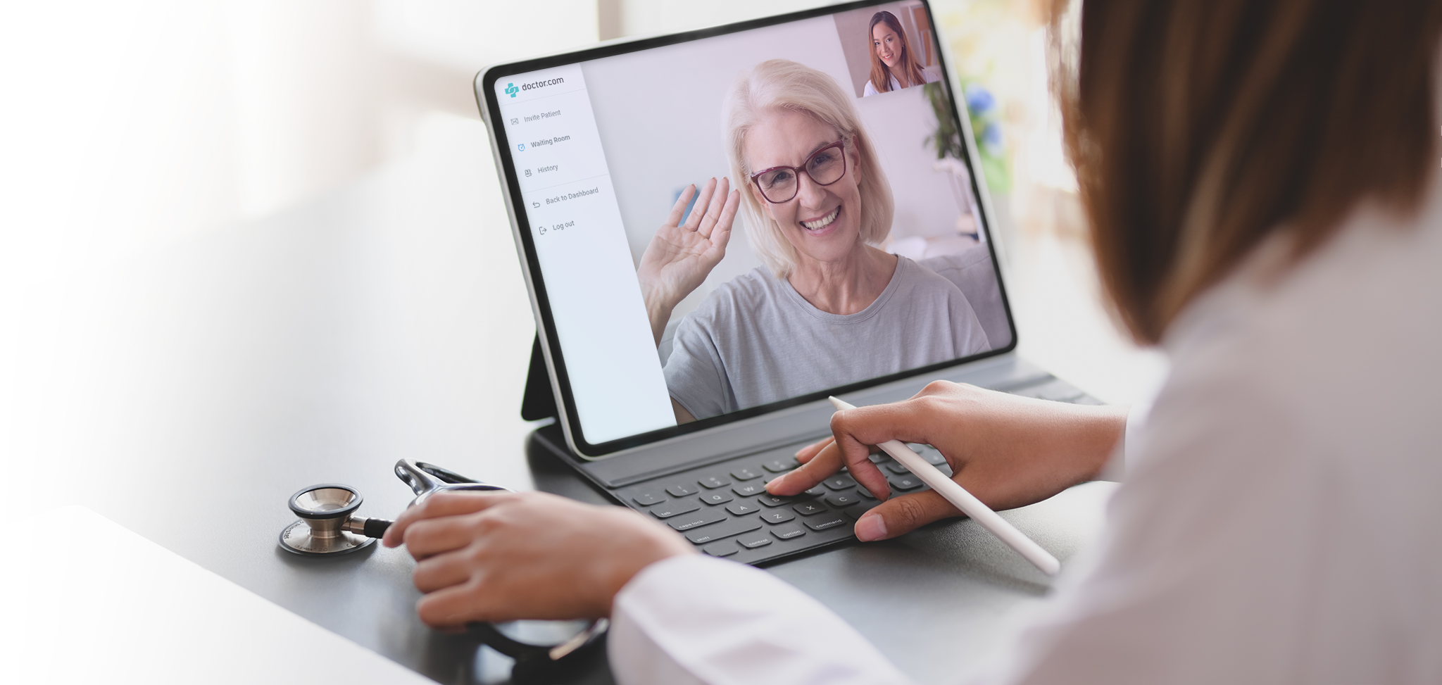 Doctor interacting with a patient via VirtualVisit app on a notebook